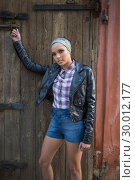 Купить «Woman with hairband posing and looking at camera», фото № 30012177, снято 16 мая 2013 г. (c) Wavebreak Media / Фотобанк Лори