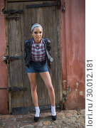 Купить «Attractive woman in high heels posing and looking at camera», фото № 30012181, снято 16 мая 2013 г. (c) Wavebreak Media / Фотобанк Лори