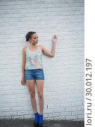 Neutral woman posing . Стоковое фото, агентство Wavebreak Media / Фотобанк Лори