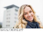 Купить «Happy attractive blonde posing outdoors», фото № 30012277, снято 15 мая 2013 г. (c) Wavebreak Media / Фотобанк Лори