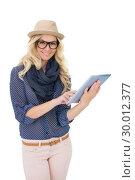 Купить «Happy trendy blonde holding tablet computer», фото № 30012377, снято 15 мая 2013 г. (c) Wavebreak Media / Фотобанк Лори
