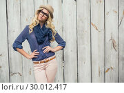 Купить «Day dreaming trendy blonde posing», фото № 30012417, снято 15 мая 2013 г. (c) Wavebreak Media / Фотобанк Лори