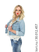 Купить «Pensive casual blonde wearing denim clothes posing», фото № 30012457, снято 15 мая 2013 г. (c) Wavebreak Media / Фотобанк Лори