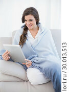 Beautiful casual brown haired woman in white pajamas shopping online with her tablet pc. Стоковое фото, агентство Wavebreak Media / Фотобанк Лори
