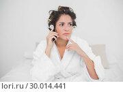 Купить «Pensive natural brunette phoning», фото № 30014441, снято 21 июня 2013 г. (c) Wavebreak Media / Фотобанк Лори