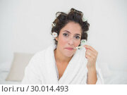 Купить «Unhappy natural brunette using thermometer», фото № 30014493, снято 21 июня 2013 г. (c) Wavebreak Media / Фотобанк Лори