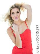 Купить «Pretty smiling blonde model looking at camera», фото № 30015877, снято 28 июня 2013 г. (c) Wavebreak Media / Фотобанк Лори