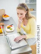 Купить «Content pretty blonde using laptop», фото № 30016241, снято 2 июля 2013 г. (c) Wavebreak Media / Фотобанк Лори
