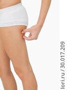 Купить «Young woman without any fat on her thigh», фото № 30017209, снято 31 июля 2013 г. (c) Wavebreak Media / Фотобанк Лори