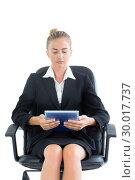 Купить «Concentrated young businesswoman making use of her tablet», фото № 30017737, снято 28 июня 2013 г. (c) Wavebreak Media / Фотобанк Лори
