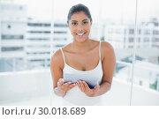 Купить «Lucky toned brunette using tablet», фото № 30018689, снято 8 мая 2013 г. (c) Wavebreak Media / Фотобанк Лори