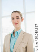 Купить «Lovely chic businesswoman posing seriously in her office», фото № 30019897, снято 17 июля 2013 г. (c) Wavebreak Media / Фотобанк Лори