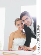 Handsome young bridegroom signing wedding contract. Стоковое фото, агентство Wavebreak Media / Фотобанк Лори