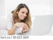 Купить «Attractive woman making smiling use of her notebook», фото № 30021669, снято 3 июля 2013 г. (c) Wavebreak Media / Фотобанк Лори