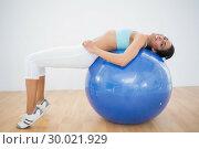 Купить «Cute sporty woman stretching on fitness ball », фото № 30021929, снято 4 июля 2013 г. (c) Wavebreak Media / Фотобанк Лори