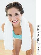 Купить «Smiling woman with towel around neck at fitness studio», фото № 30022329, снято 10 июля 2013 г. (c) Wavebreak Media / Фотобанк Лори