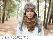 Купить «Woman wearing fur hat with woolen scarf and jacket in woods», фото № 30023713, снято 20 августа 2013 г. (c) Wavebreak Media / Фотобанк Лори