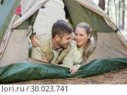 Купить «Loving couple lying in tent after a hike», фото № 30023741, снято 20 августа 2013 г. (c) Wavebreak Media / Фотобанк Лори