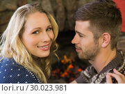 Купить «Close up of a romantic couple in front of fireplace», фото № 30023981, снято 21 августа 2013 г. (c) Wavebreak Media / Фотобанк Лори