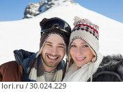 Купить «Close up portrait of a smiling couple in woolen hats», фото № 30024229, снято 22 августа 2013 г. (c) Wavebreak Media / Фотобанк Лори