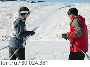 Купить «Side view of a smiling couple with ski poles on snow», фото № 30024381, снято 22 августа 2013 г. (c) Wavebreak Media / Фотобанк Лори