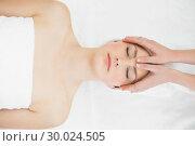 Купить «Hands massaging a beautiful womans forehead», фото № 30024505, снято 23 июля 2013 г. (c) Wavebreak Media / Фотобанк Лори
