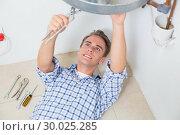 Купить «Technician servicing an hot water heater», фото № 30025285, снято 25 июля 2013 г. (c) Wavebreak Media / Фотобанк Лори