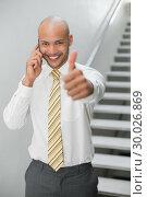 Купить «Businessman using cellphone and gesturing thumbs up», фото № 30026869, снято 1 августа 2013 г. (c) Wavebreak Media / Фотобанк Лори