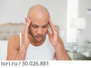 Купить «Bald man suffering from headache in bed», фото № 30026881, снято 1 августа 2013 г. (c) Wavebreak Media / Фотобанк Лори