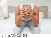 Купить «Thoughtful bald man with head in hands on bed», фото № 30026889, снято 1 августа 2013 г. (c) Wavebreak Media / Фотобанк Лори