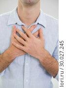 Купить «Mid section of a man with chest pain», фото № 30027245, снято 2 августа 2013 г. (c) Wavebreak Media / Фотобанк Лори