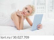 Купить «Thoughtful casual blond with tablet PC lying in bed», фото № 30027709, снято 6 августа 2013 г. (c) Wavebreak Media / Фотобанк Лори