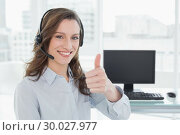 Купить «Businesswoman wearing headset while gesturing thumbs up in office», фото № 30027977, снято 7 августа 2013 г. (c) Wavebreak Media / Фотобанк Лори