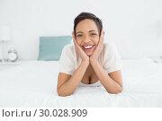 Купить «Portrait of a cheerful woman relaxing in bed», фото № 30028909, снято 13 августа 2013 г. (c) Wavebreak Media / Фотобанк Лори