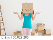 Купить «Woman in blue tank top with smiley cardboard box over face», фото № 30029205, снято 13 августа 2013 г. (c) Wavebreak Media / Фотобанк Лори