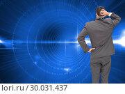 Купить «Composite image of young businessman standing back to camera scratching his head», фото № 30031437, снято 1 ноября 2013 г. (c) Wavebreak Media / Фотобанк Лори