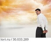 Купить «Composite image of rear view of young businessman wearing handcuffs», фото № 30033289, снято 2 ноября 2013 г. (c) Wavebreak Media / Фотобанк Лори