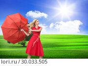 Купить «Composite image of beautiful woman posing with a broken umbrella», фото № 30033505, снято 2 ноября 2013 г. (c) Wavebreak Media / Фотобанк Лори