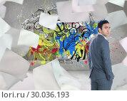 Купить «Composite image of unsmiling businessman standing», фото № 30036193, снято 9 ноября 2013 г. (c) Wavebreak Media / Фотобанк Лори