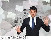 Composite image of unsmiling businessman touching. Стоковое фото, агентство Wavebreak Media / Фотобанк Лори