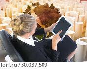 Купить «Composite image of businesswoman sitting on swivel chair with tablet», фото № 30037509, снято 9 ноября 2013 г. (c) Wavebreak Media / Фотобанк Лори