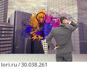 Composite image of young businessman standing back to camera scratching his head. Стоковое фото, агентство Wavebreak Media / Фотобанк Лори