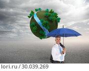 Купить «Composite image of businessman holding umbrella smiling at camera», фото № 30039269, снято 10 ноября 2013 г. (c) Wavebreak Media / Фотобанк Лори