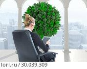 Купить «Composite image of businesswoman sitting on swivel chair with tablet», фото № 30039309, снято 10 ноября 2013 г. (c) Wavebreak Media / Фотобанк Лори