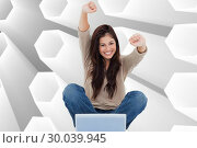 Купить «Composite image of woman looks straight ahead as she celebrates in front of her laptop», фото № 30039945, снято 10 ноября 2013 г. (c) Wavebreak Media / Фотобанк Лори
