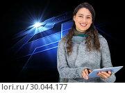 Купить «Composite image of smiling model wearing winter clothes holding her tablet», фото № 30044177, снято 11 ноября 2013 г. (c) Wavebreak Media / Фотобанк Лори