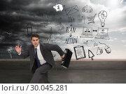 Купить «Composite image of stern businessman in a hury», фото № 30045281, снято 11 ноября 2013 г. (c) Wavebreak Media / Фотобанк Лори