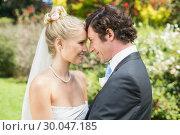 Купить «Pretty blonde wife hugging her new husband», фото № 30047185, снято 9 октября 2013 г. (c) Wavebreak Media / Фотобанк Лори