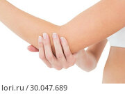 Closeup mid section of a woman with elbow pain. Стоковое фото, агентство Wavebreak Media / Фотобанк Лори