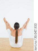 Купить «Toned woman doing the balancing bear posture», фото № 30047933, снято 15 октября 2013 г. (c) Wavebreak Media / Фотобанк Лори